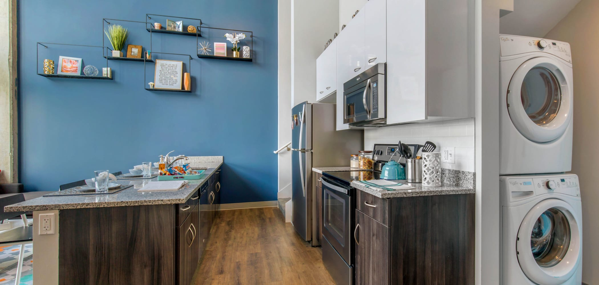 Fully equipped kitchen and in-unit washer and dryer at HERE Champaign in Champaign, Illinois