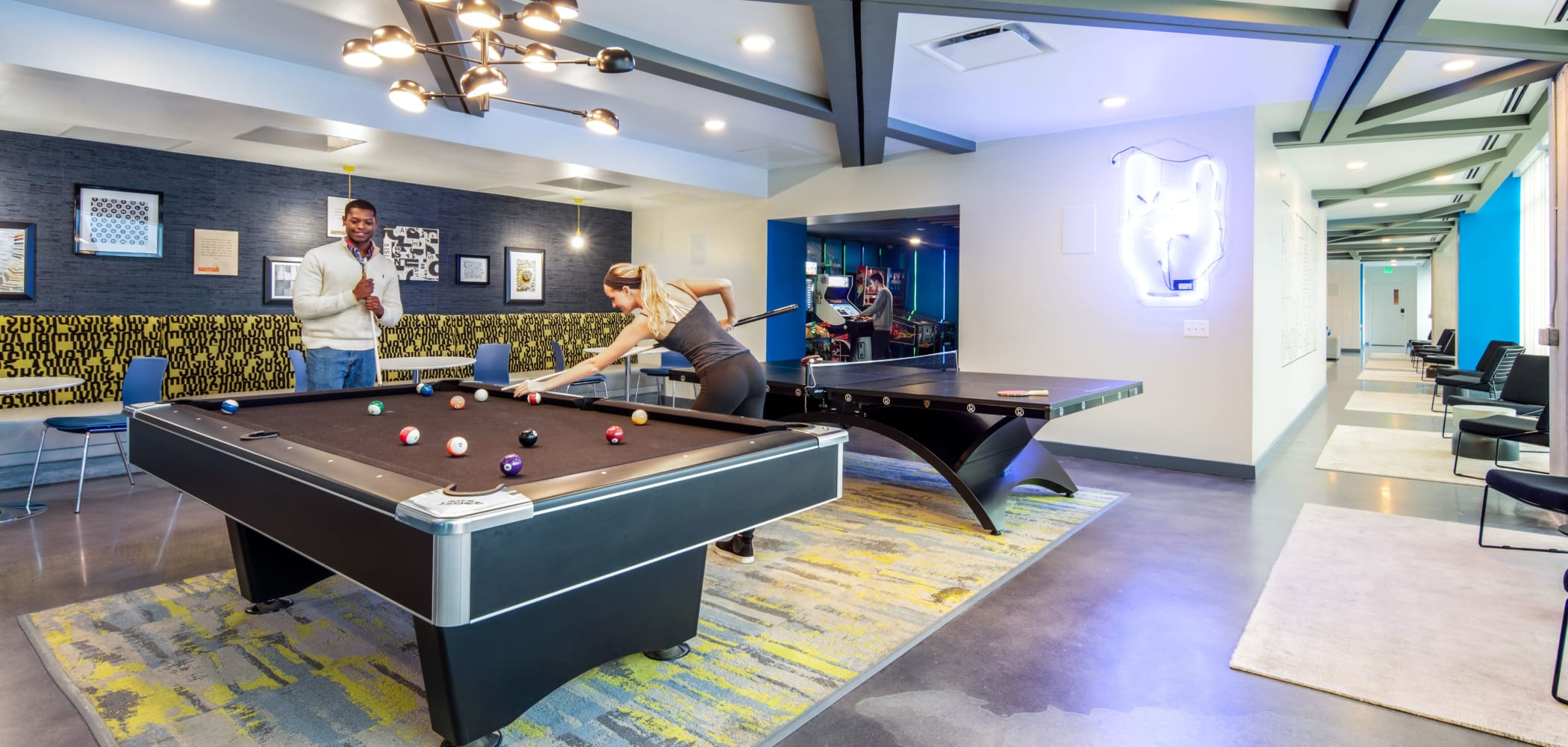 Game room with a billiards table at RISE at Riverfront Crossings in Iowa City, Iowa