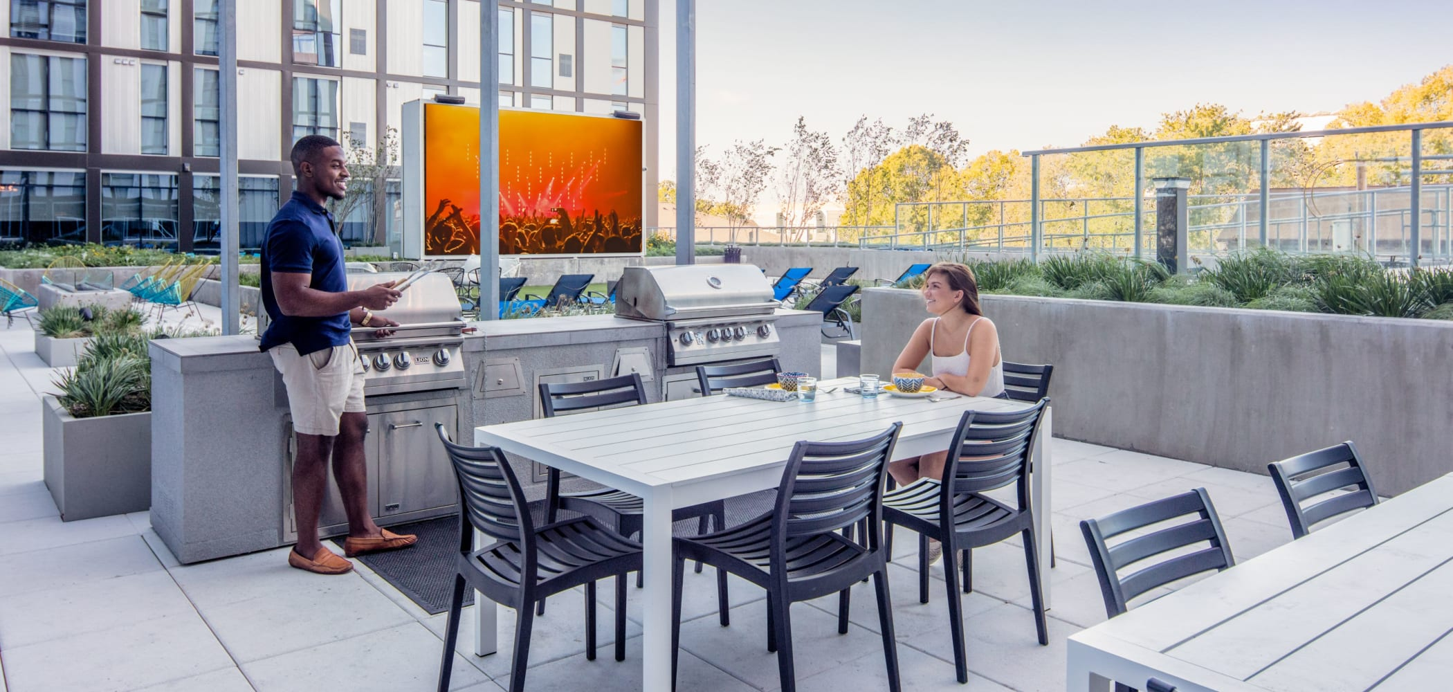Outdoor grill and chill area at RISE at Riverfront Crossings in Iowa City, Iowa