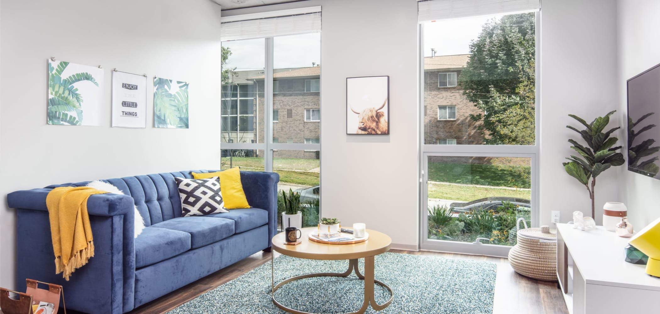 Bright living room with a view at RISE at Riverfront Crossings in Iowa City, Iowa