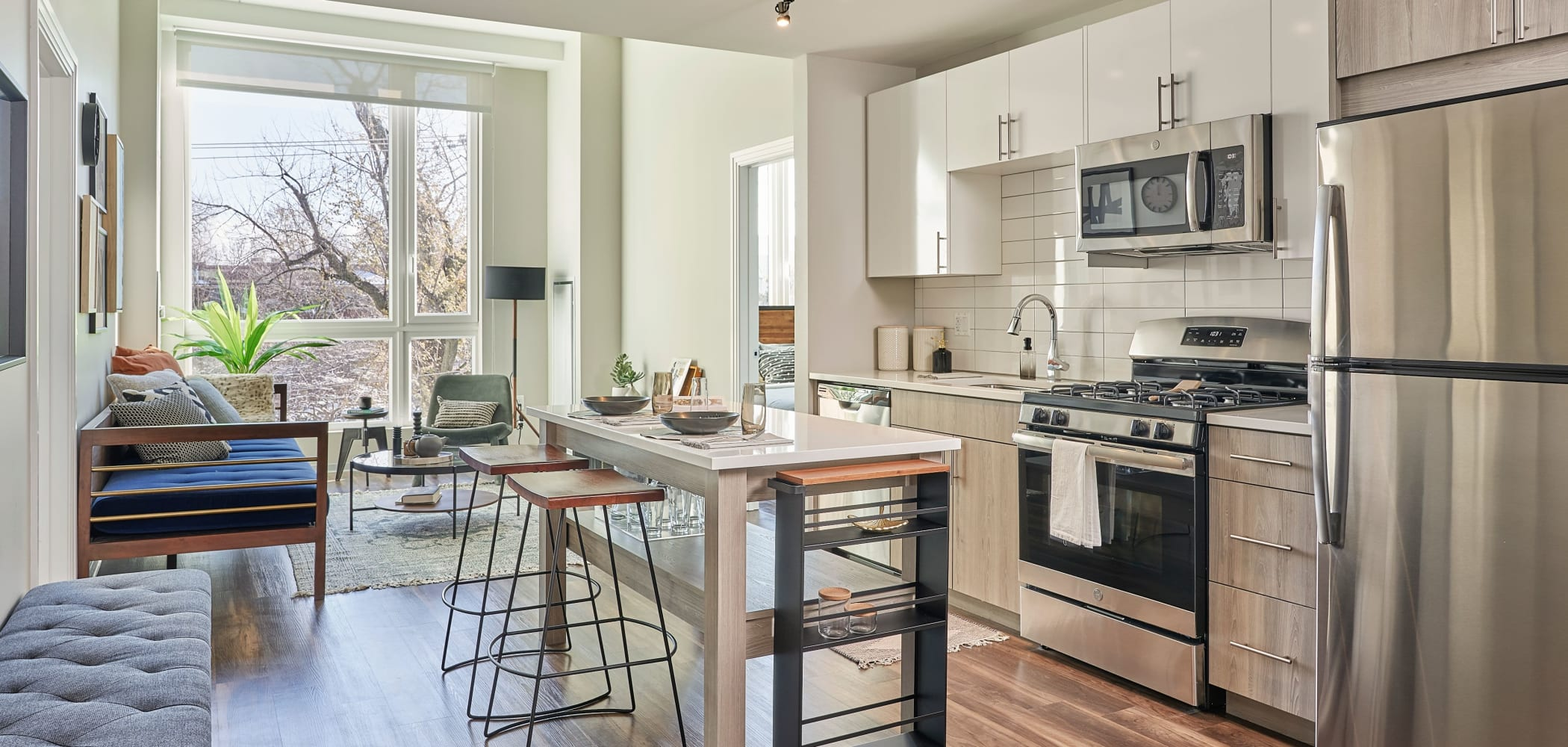 Kitchen with wood style flooring at The Link Evanston in Evanston, Illinois