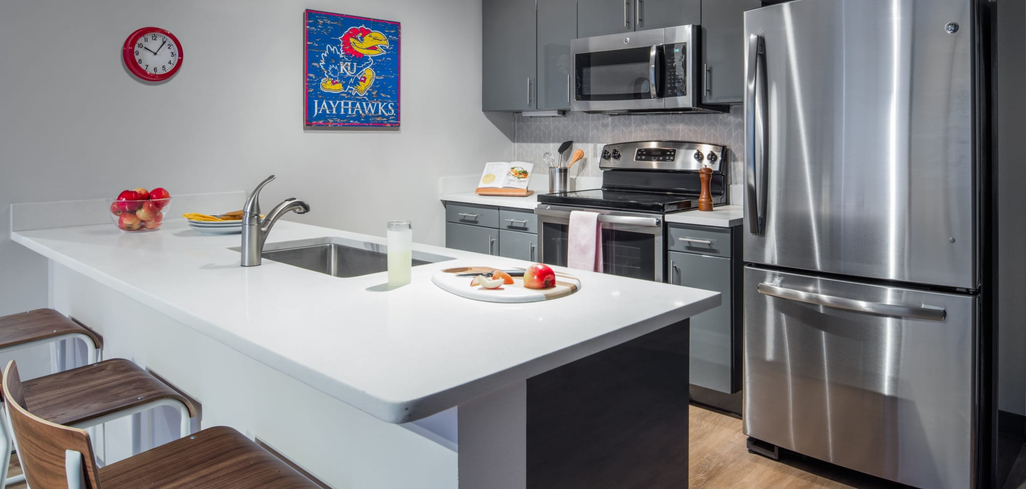 Kitchen with stainless steel appliances at HERE Kansas in Lawrence, Kansas
