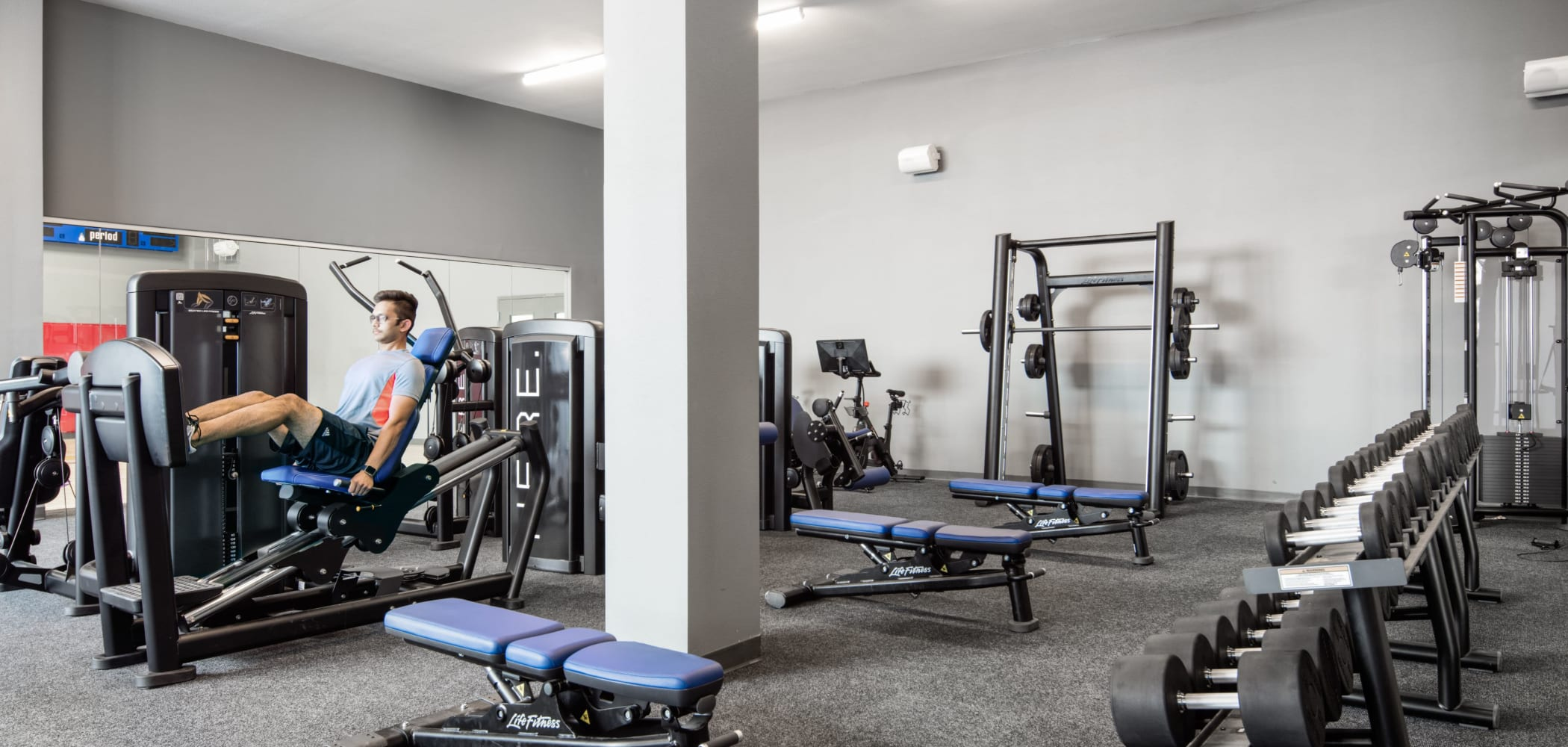 Fully equipped fitness center for residents at HERE Kansas in Lawrence, Kansas