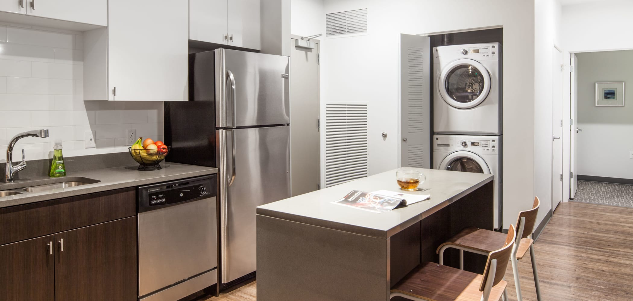 Kitchen with a washer and dryer at LATITUDE in Lincoln, Nebraska
