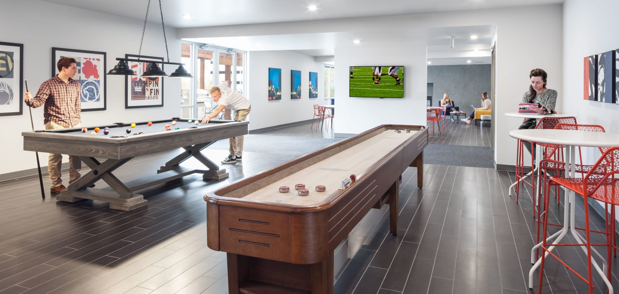 Game room with a shuffleboard table at LATITUDE in Lincoln, Nebraska