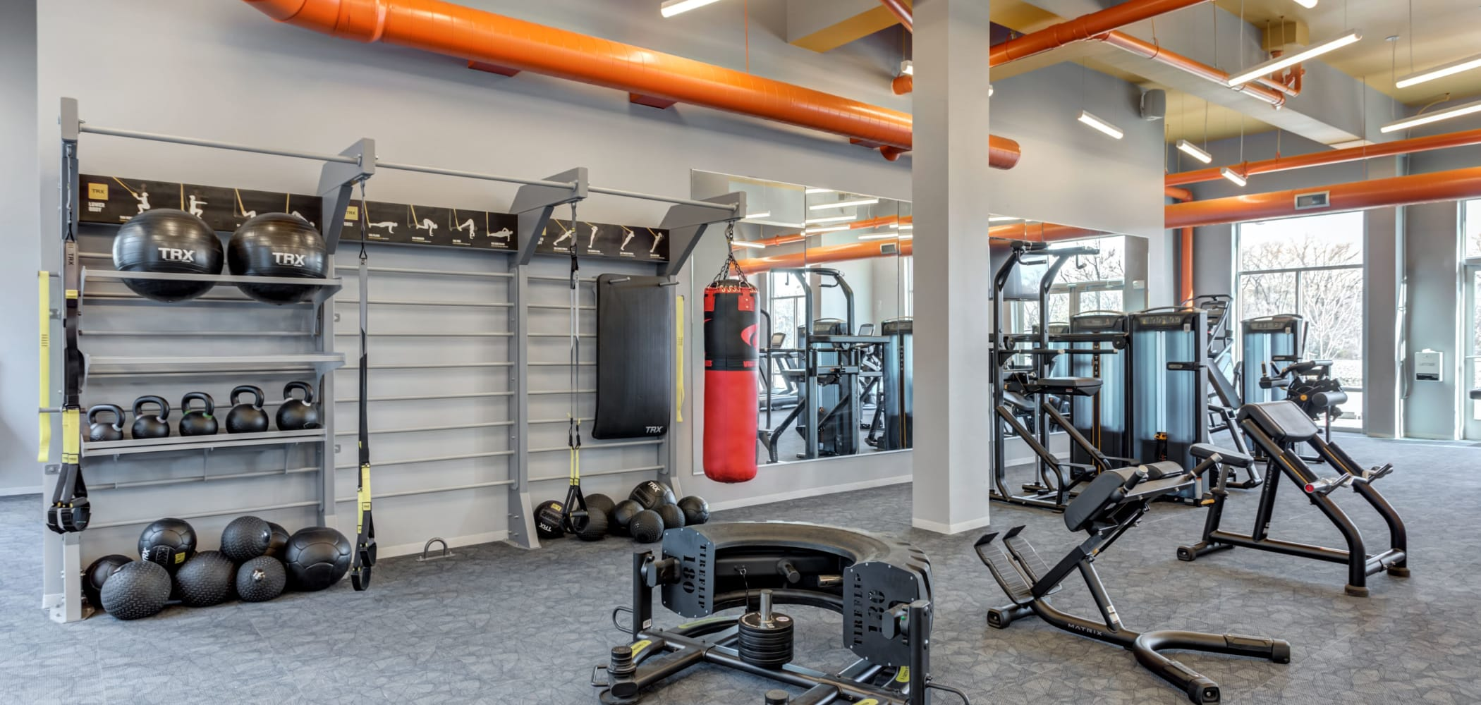 Fully equipped fitness center at LATITUDE at River Landing in Coralville, Iowa
