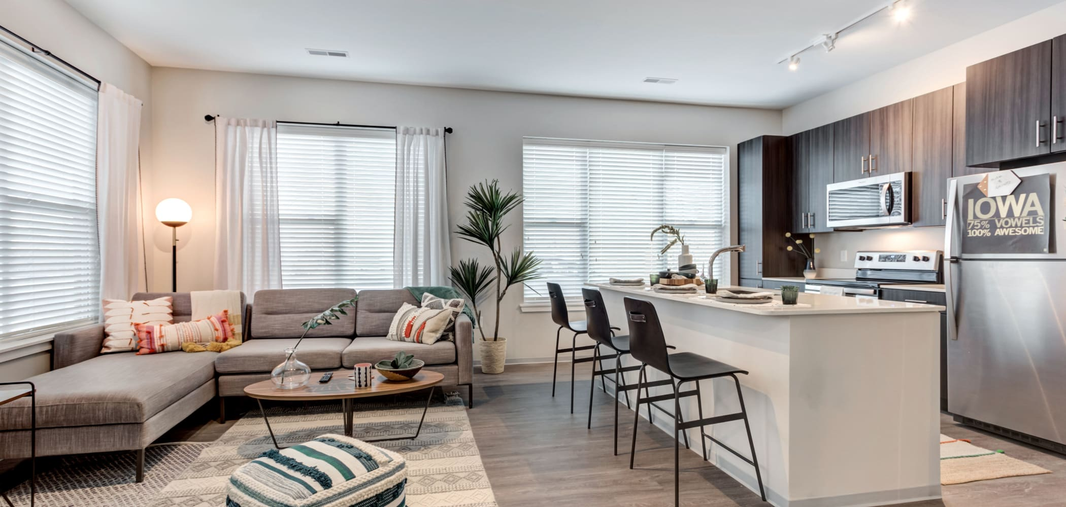 Open-concept living spaces at LATITUDE at River Landing in Coralville, Iowa