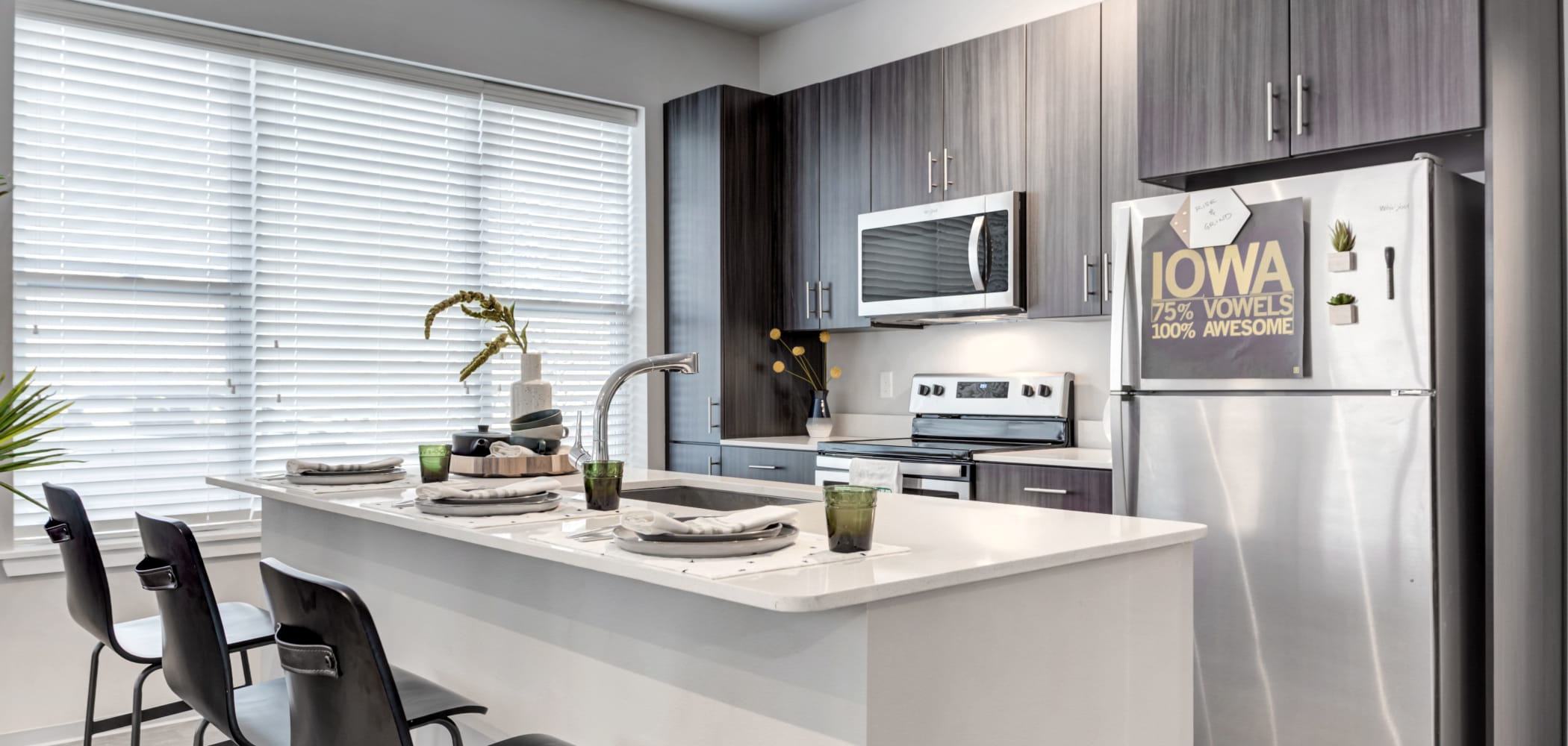 Modern kitchen at LATITUDE at River Landing in Coralville, Iowa