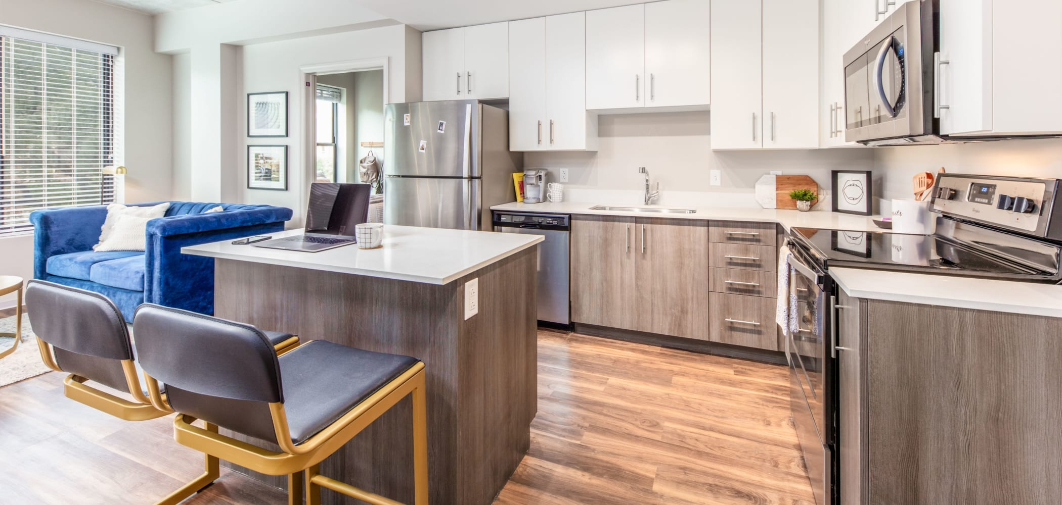 Kitchen with wood style flooring at RISE at State College in State College, Pennsylvania