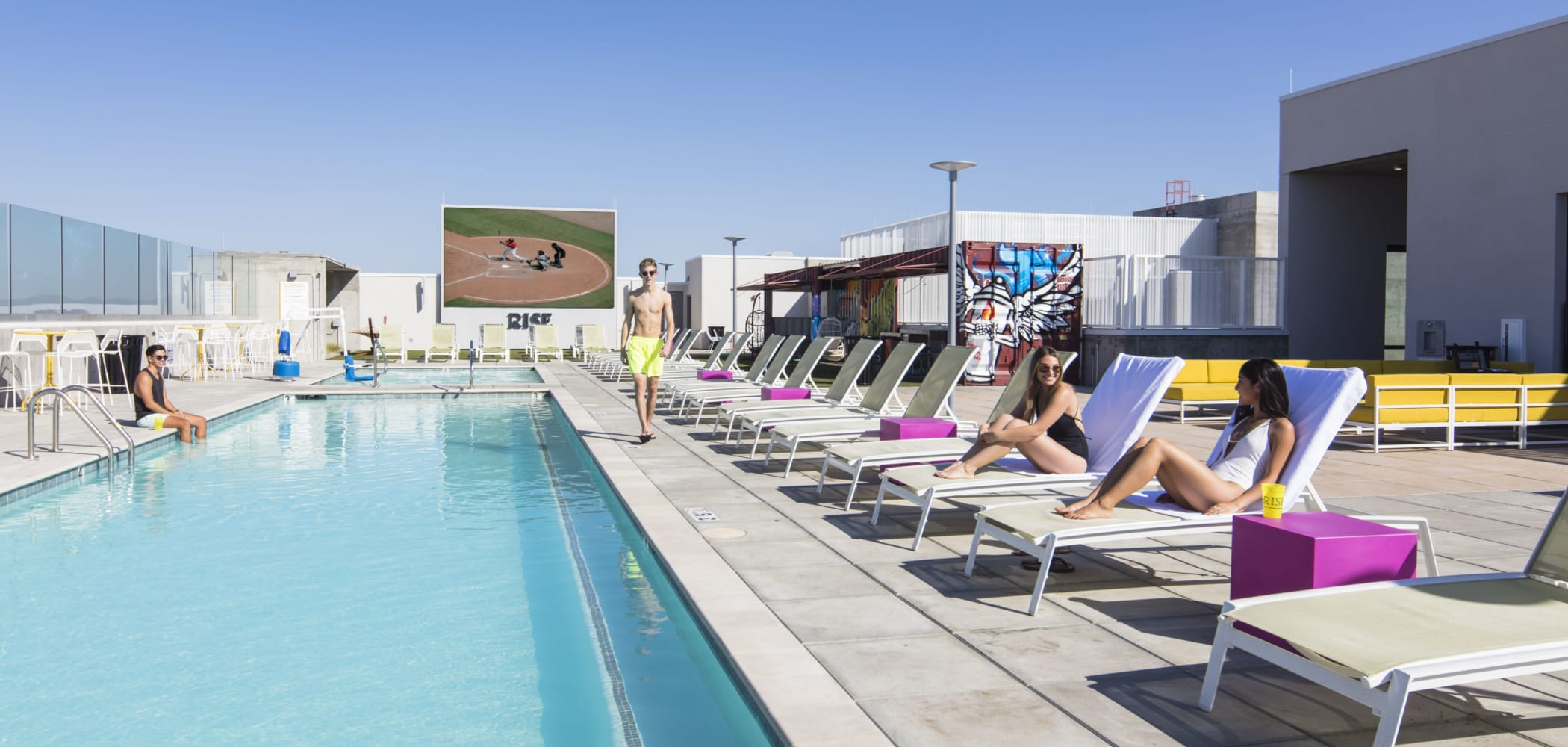 Resort-style swimming pool at RISE on Apache in Tempe, Arizona