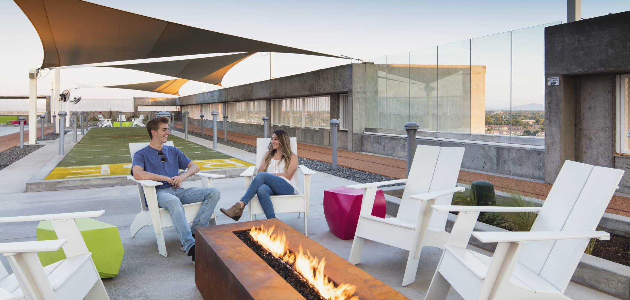 Outdoor fireside lounge at RISE on Apache in Tempe, Arizona