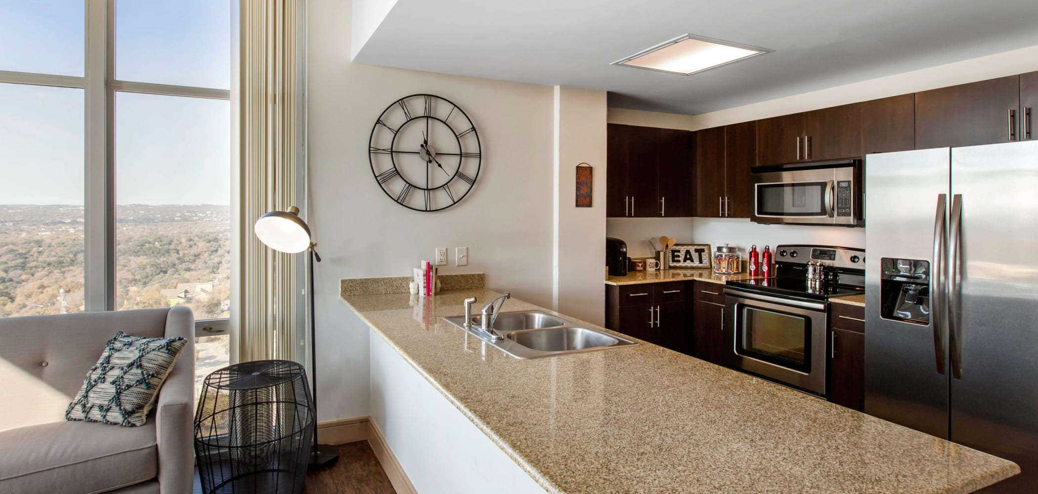 Kitchen with granite counters at 21 Rio in Austin, Texas