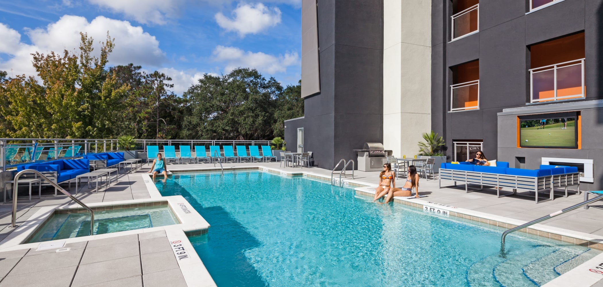 Resort-style swimming pool at Social 28 in Gainesville, Florida