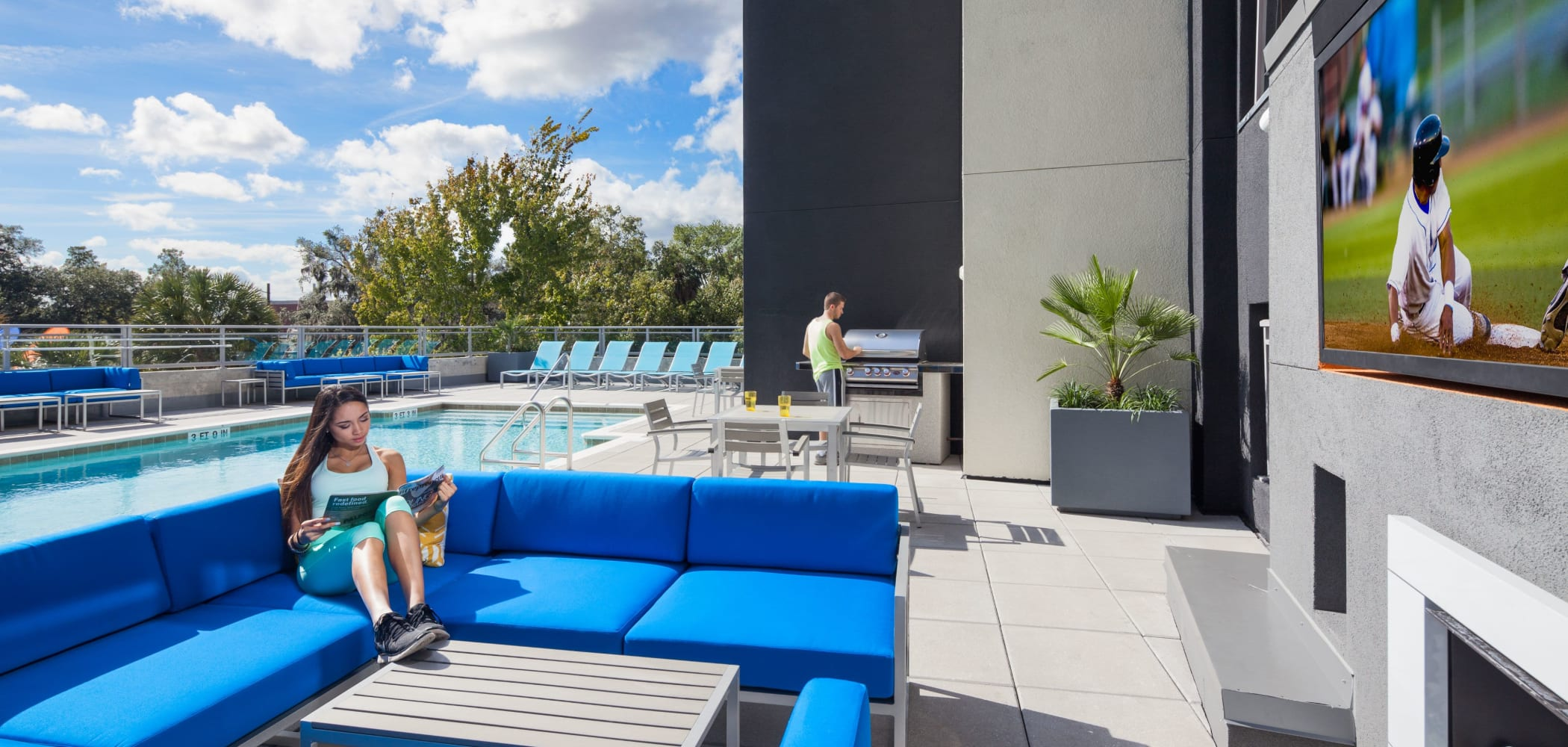 Outdoor lounge and grilling station at Social 28 in Gainesville, Florida