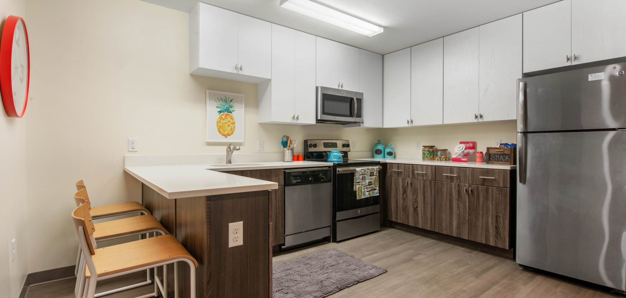 Kitchen with stainless steel appliances at Social 28 in Gainesville, Florida
