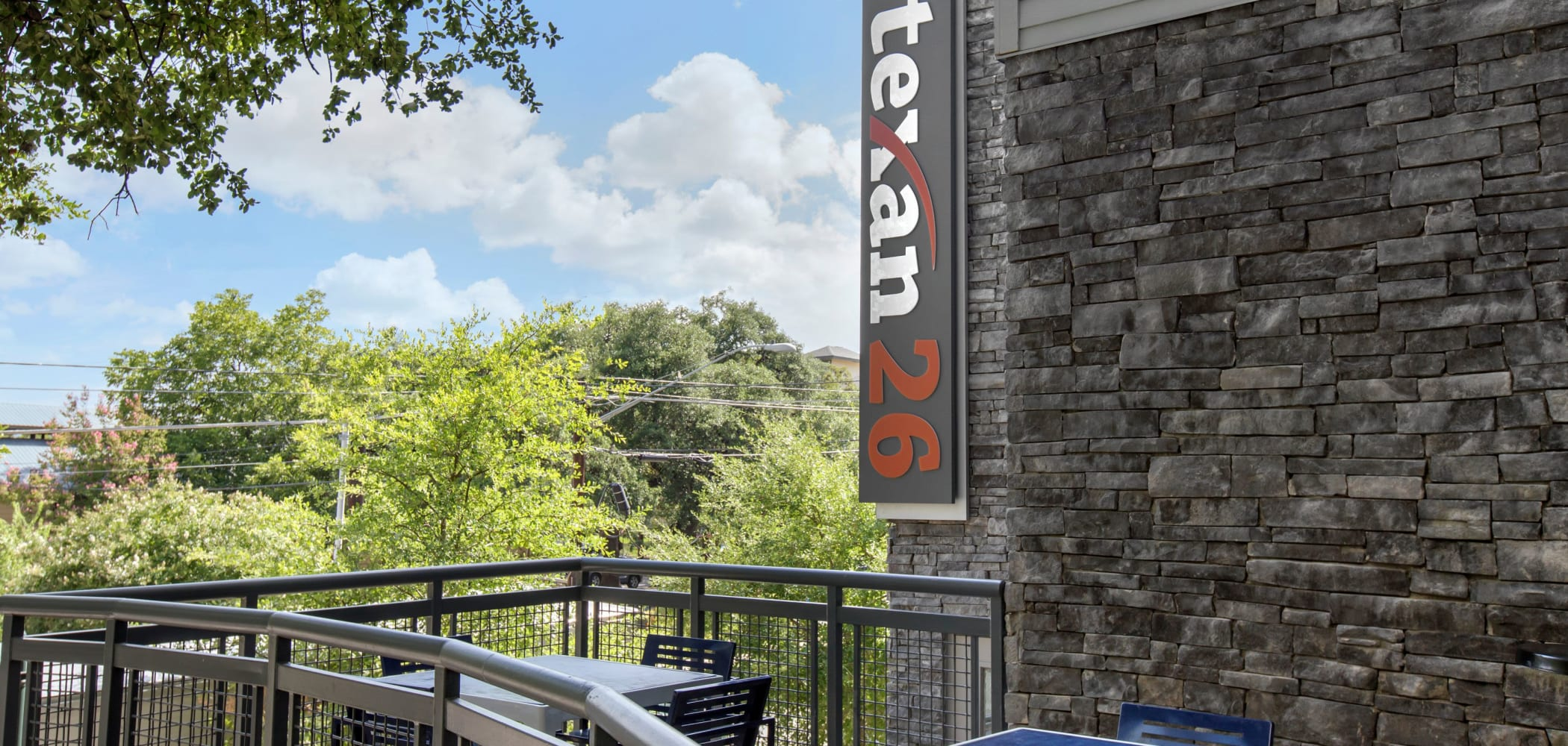 Outdoor patio area with a stunning view at Texan 26 in Austin, Texas