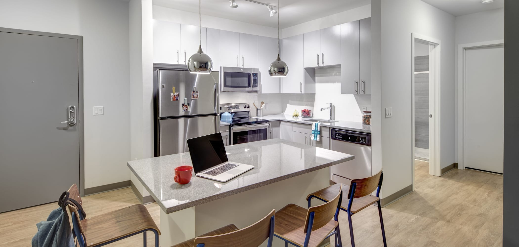 Kitchen with stainless steel appliances at West Quad in Champaign, Illinois