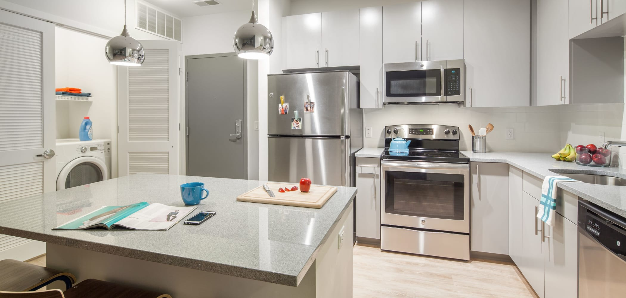 Kitchen with wood style flooring at West Quad in Champaign, Illinois