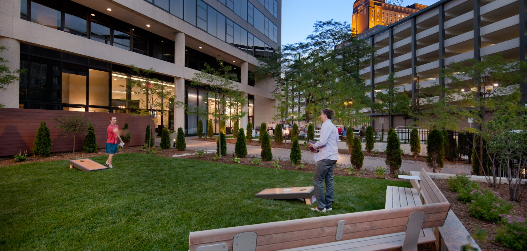 Outdoor courtyard with cornhole at The Buckler in Milwaukee, Wisconsin