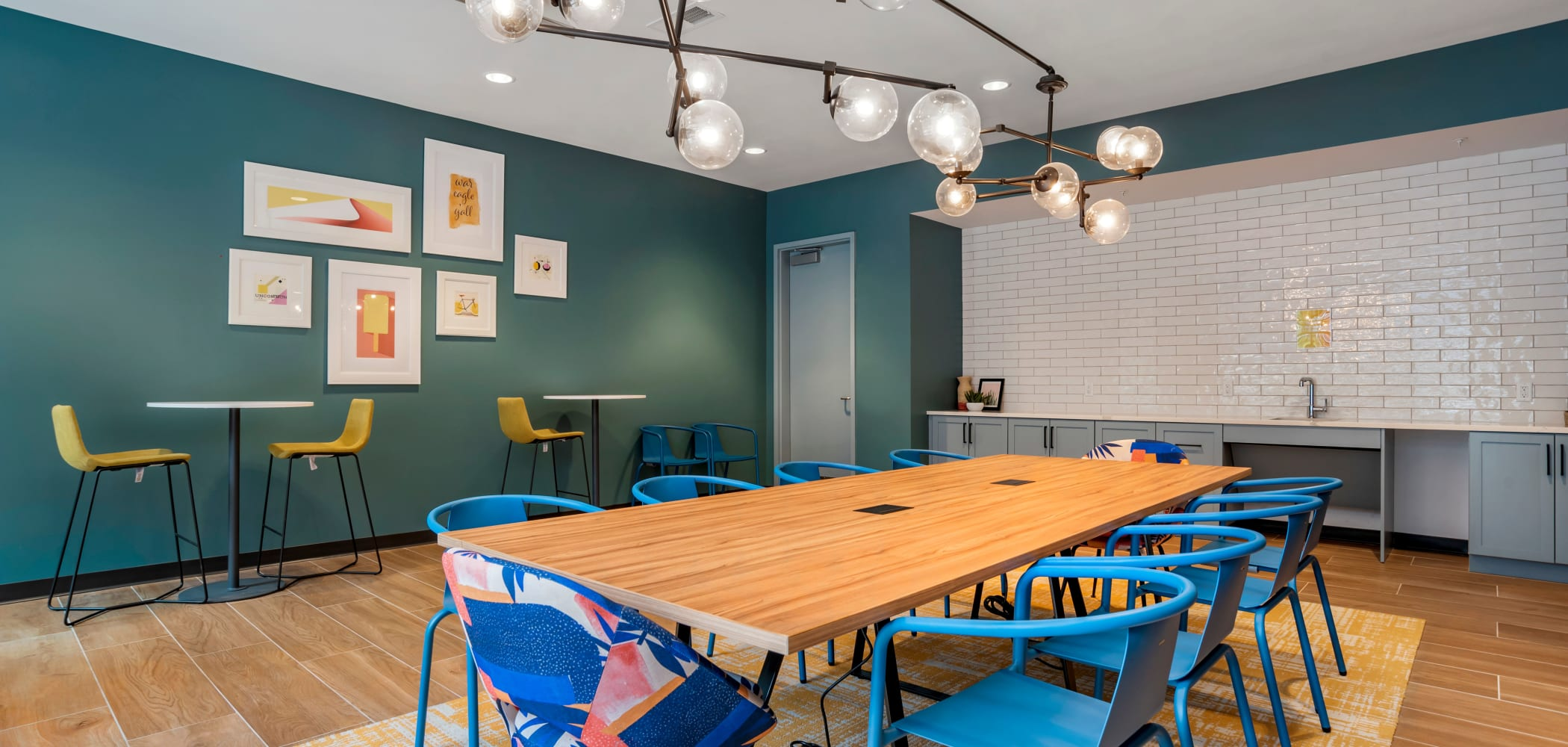 Community dining room with a kitchen at UNCOMMON Auburn in Auburn, Alabama