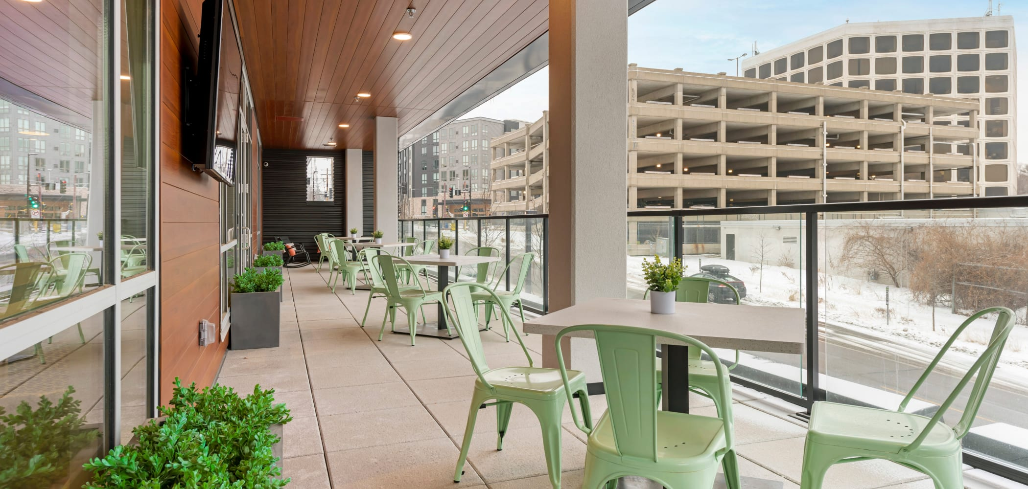 Outdoor patio area with tables and chairs at HERE Minneapolis in Minneapolis, Minnesota