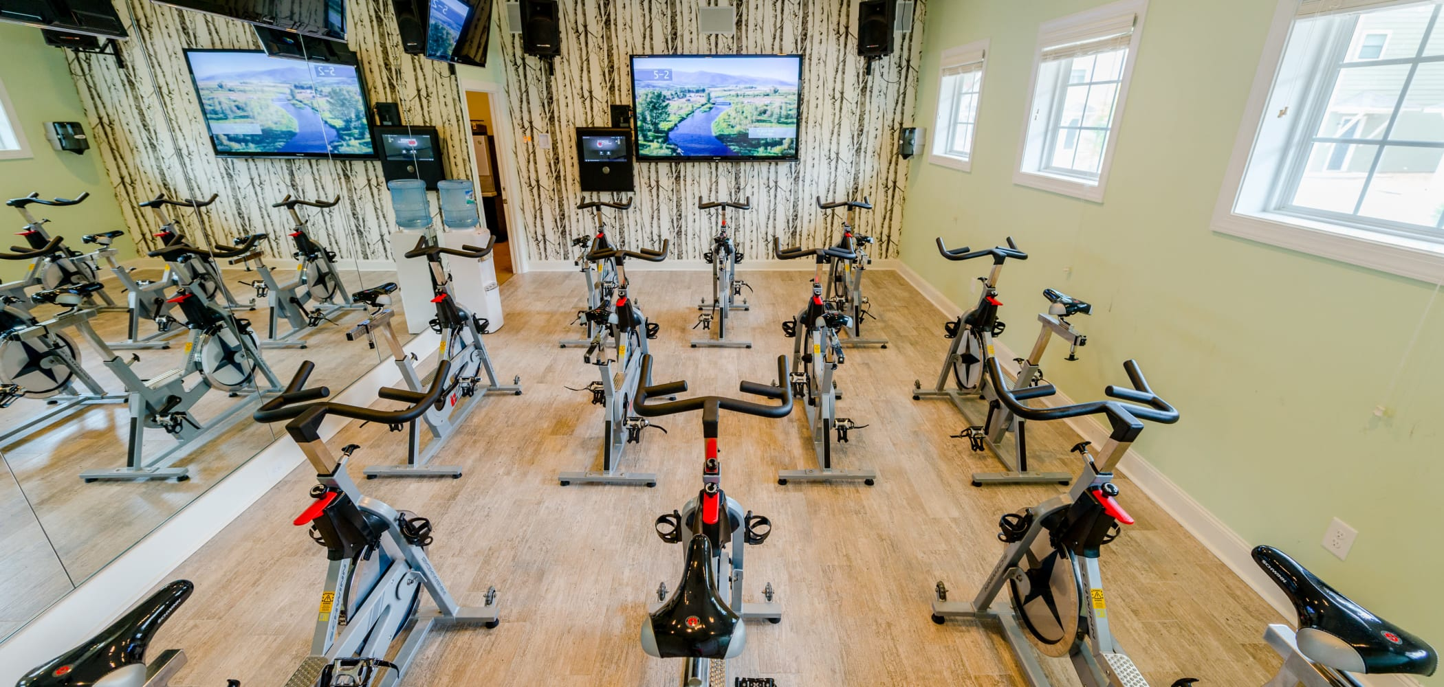 Fitness room with tons of bikes and a tv in front at Ikon Athens in Athens, Georgia