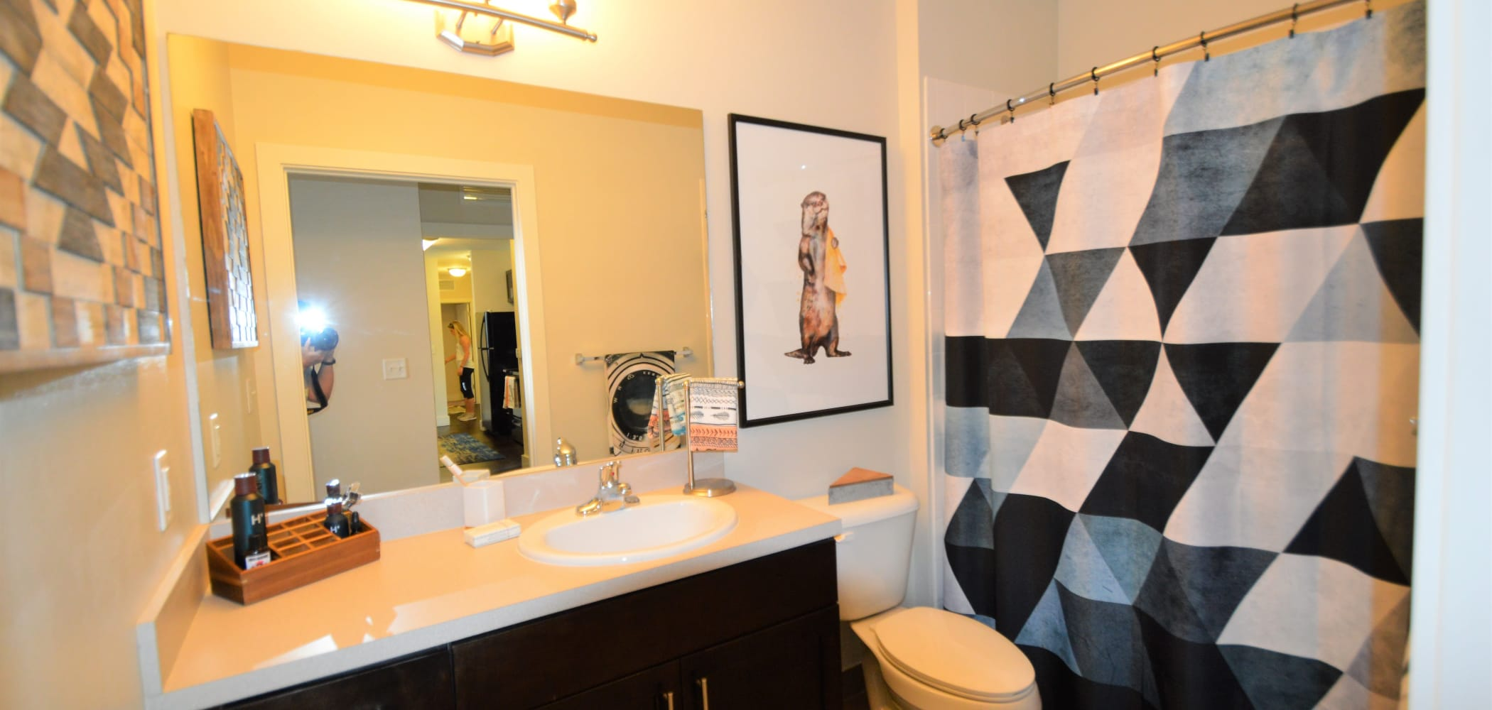 Bathroom with large mirror at University Park in Boca Raton, Florida