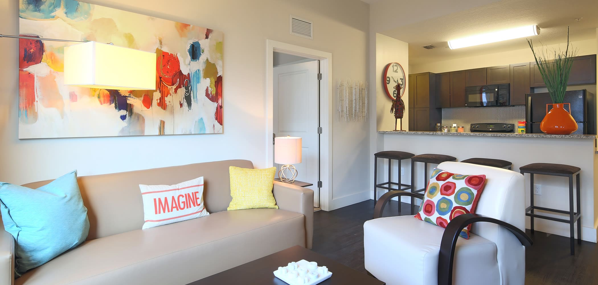 Living room and kitchen breakfast nook at University Park in Boca Raton, Florida