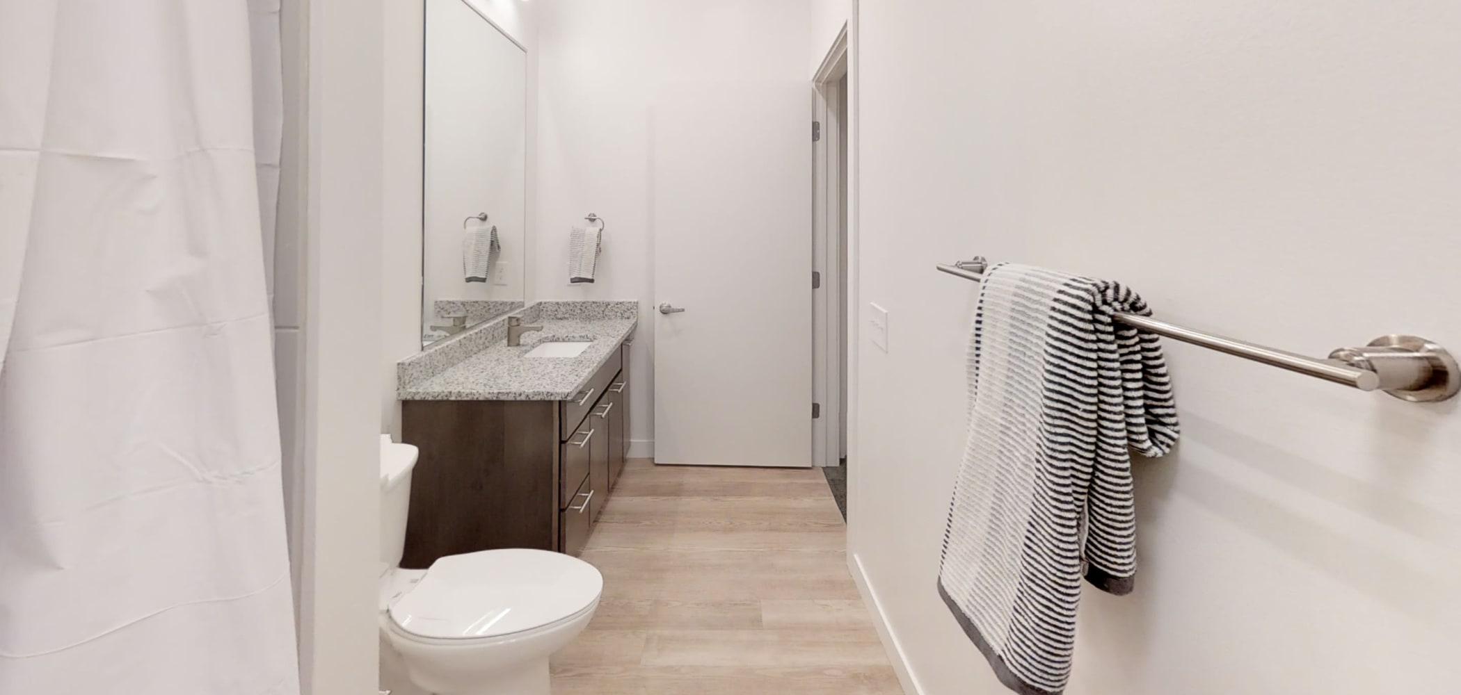 Bathroom with hardwood floors and hangers for your towels at The View on Pavey Square in Columbus, Ohio
