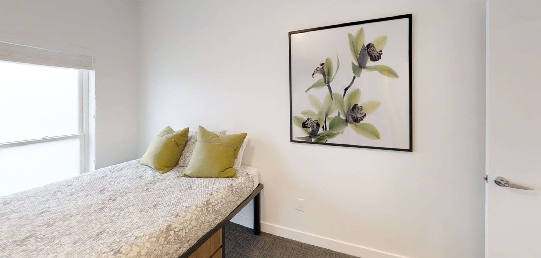 Furnished bedroom with tons of natural light and big window at The View on Pavey Square in Columbus, Ohio