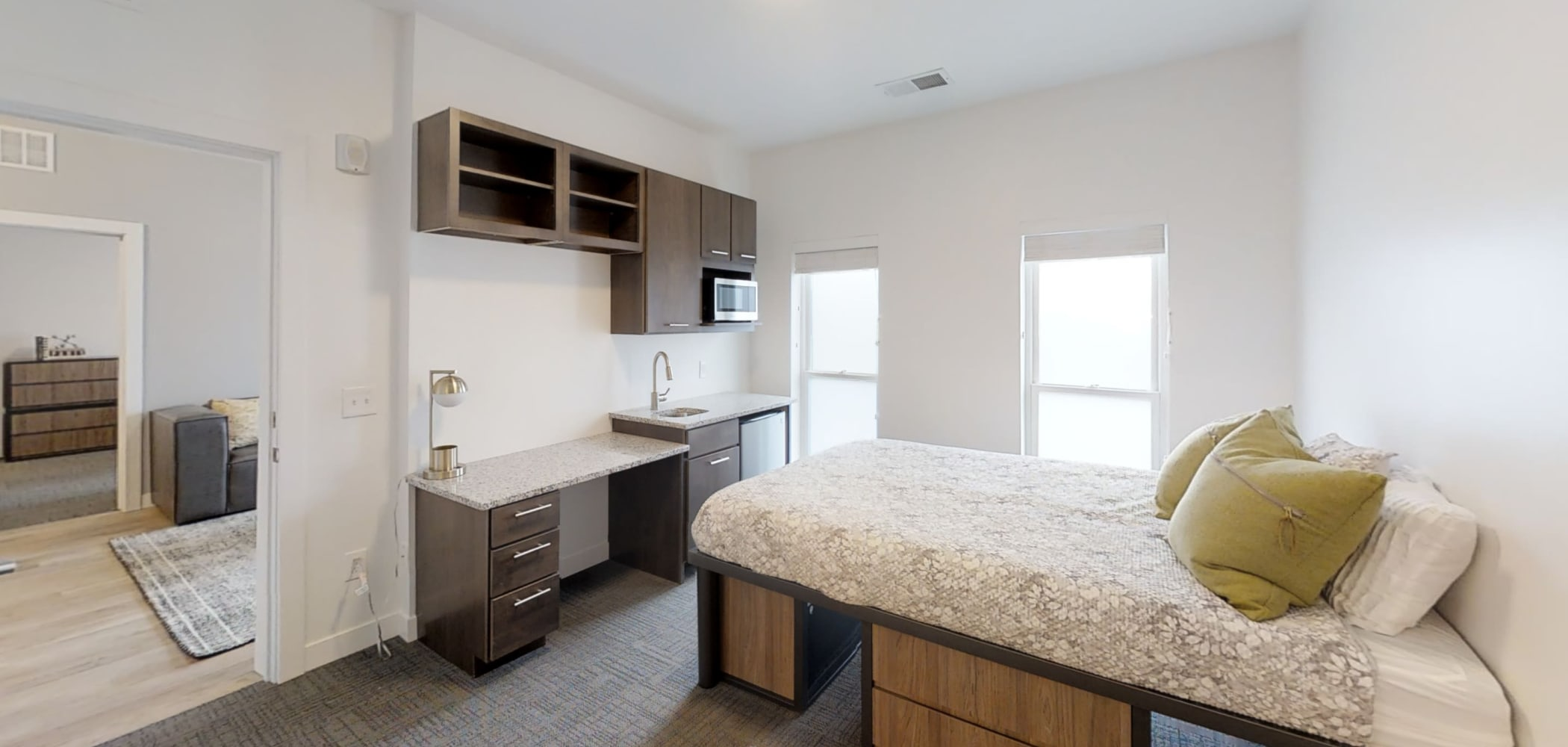 Furnished bedroom with small kitchen area at The View on Pavey Square in Columbus, Ohio
