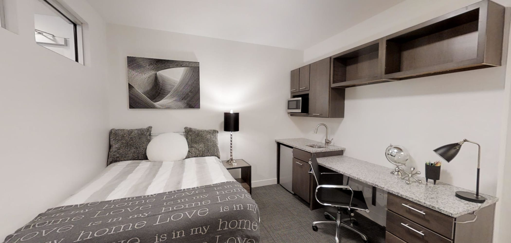 Bedroom with desk and lamp for studying at The View on Pavey Square in Columbus, Ohio