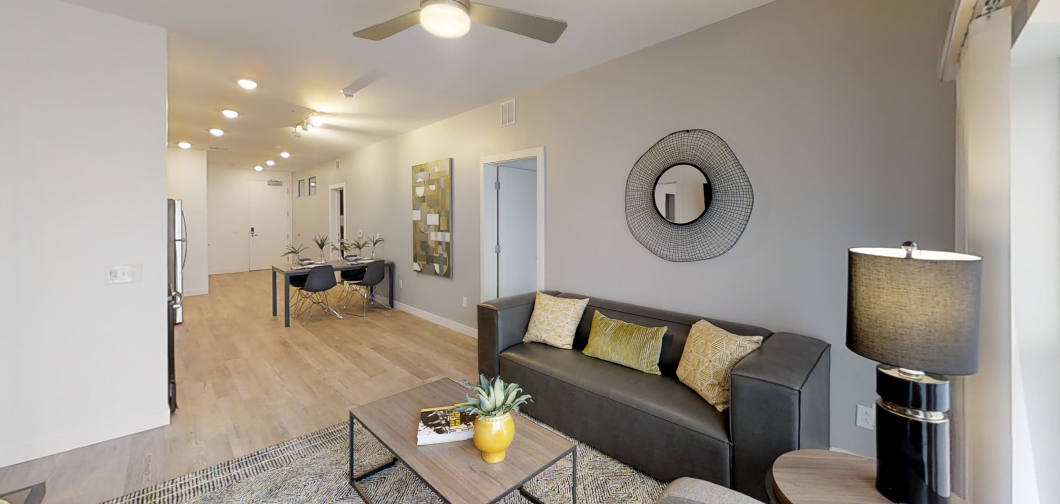 Furnished living room area with ceiling fan at The View on Pavey Square in Columbus, Ohio