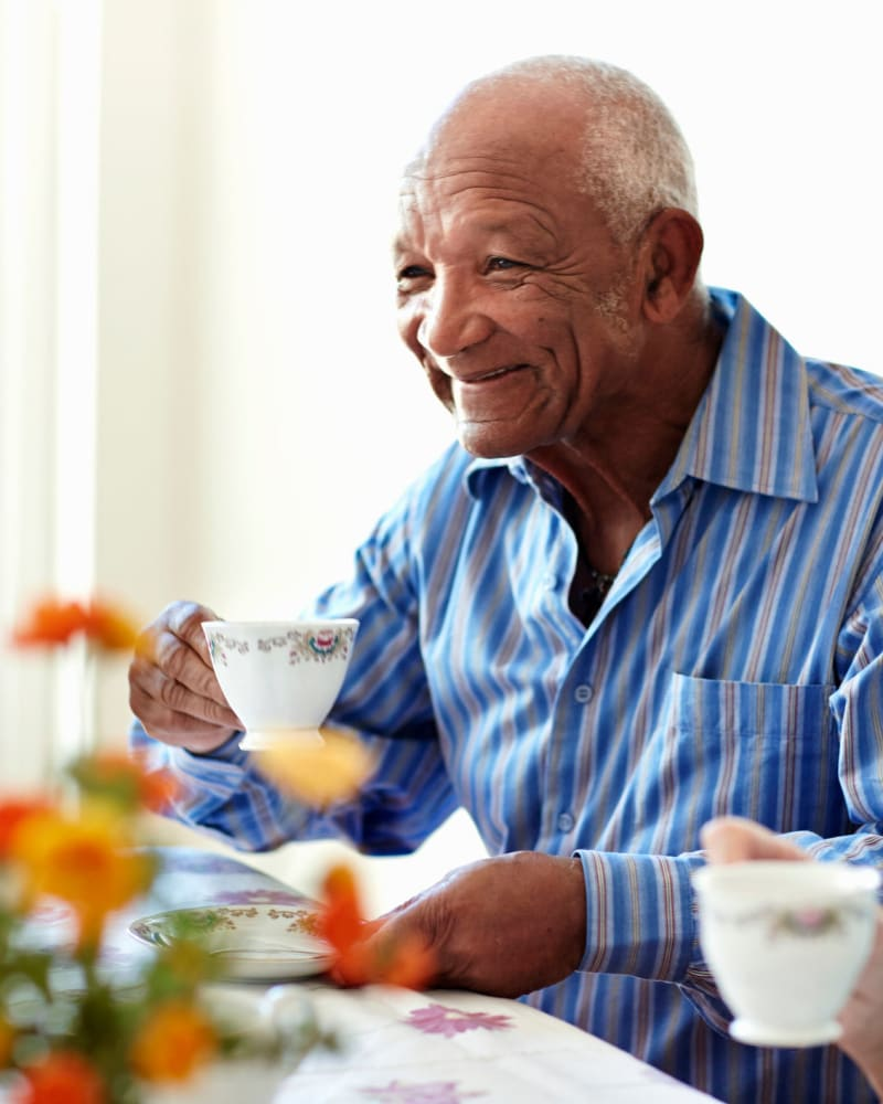 A resident eating breakfast at a Randall Residence community