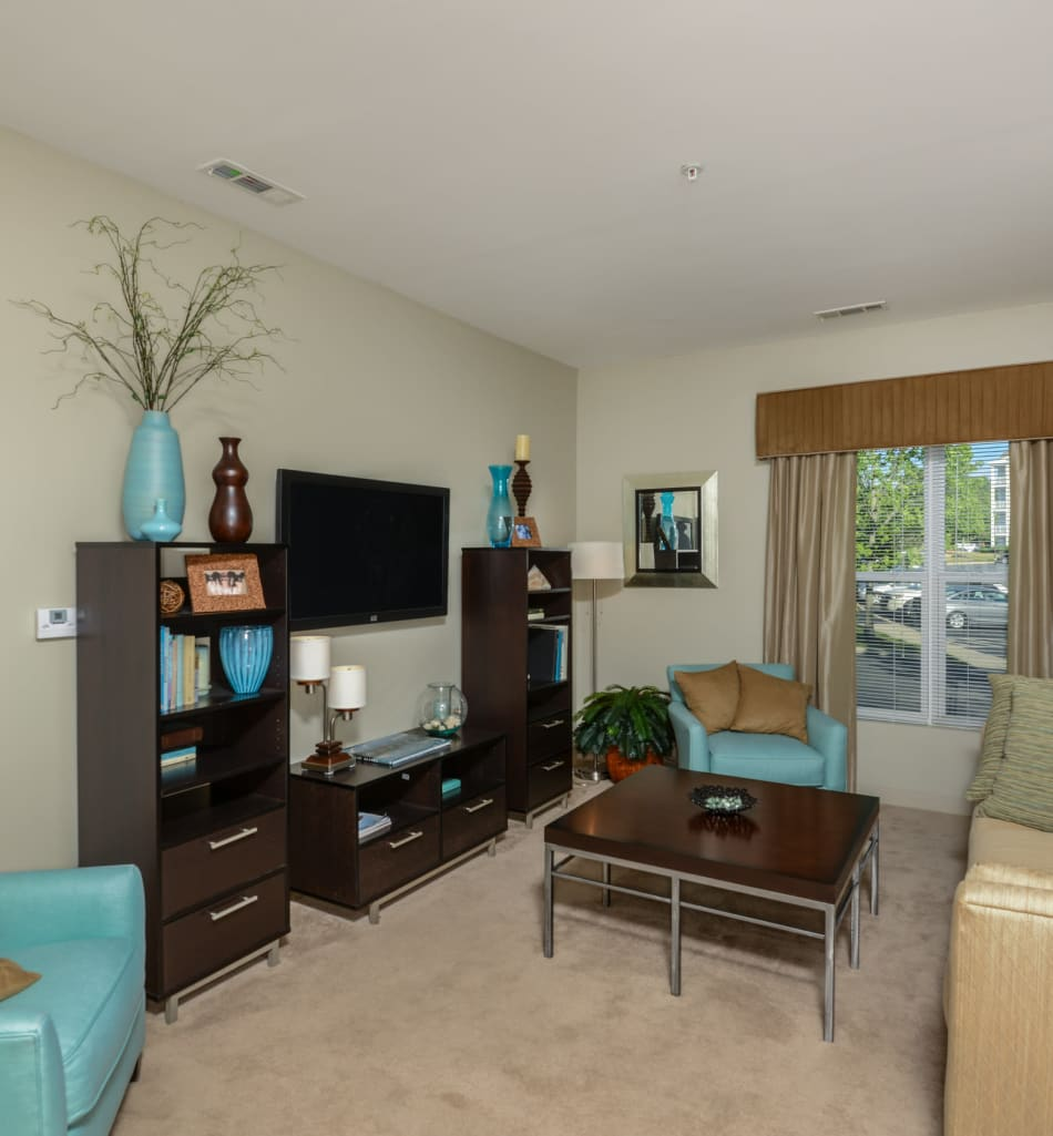 Bright and spacious living room with large window at Sofi Danvers in Danvers, Massachusetts