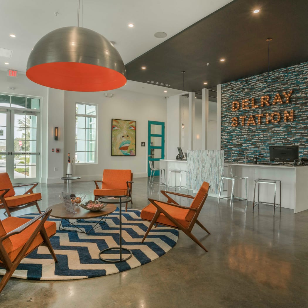 Resident clubhouse features ample seating at Delray Station in Delray Beach, Florida