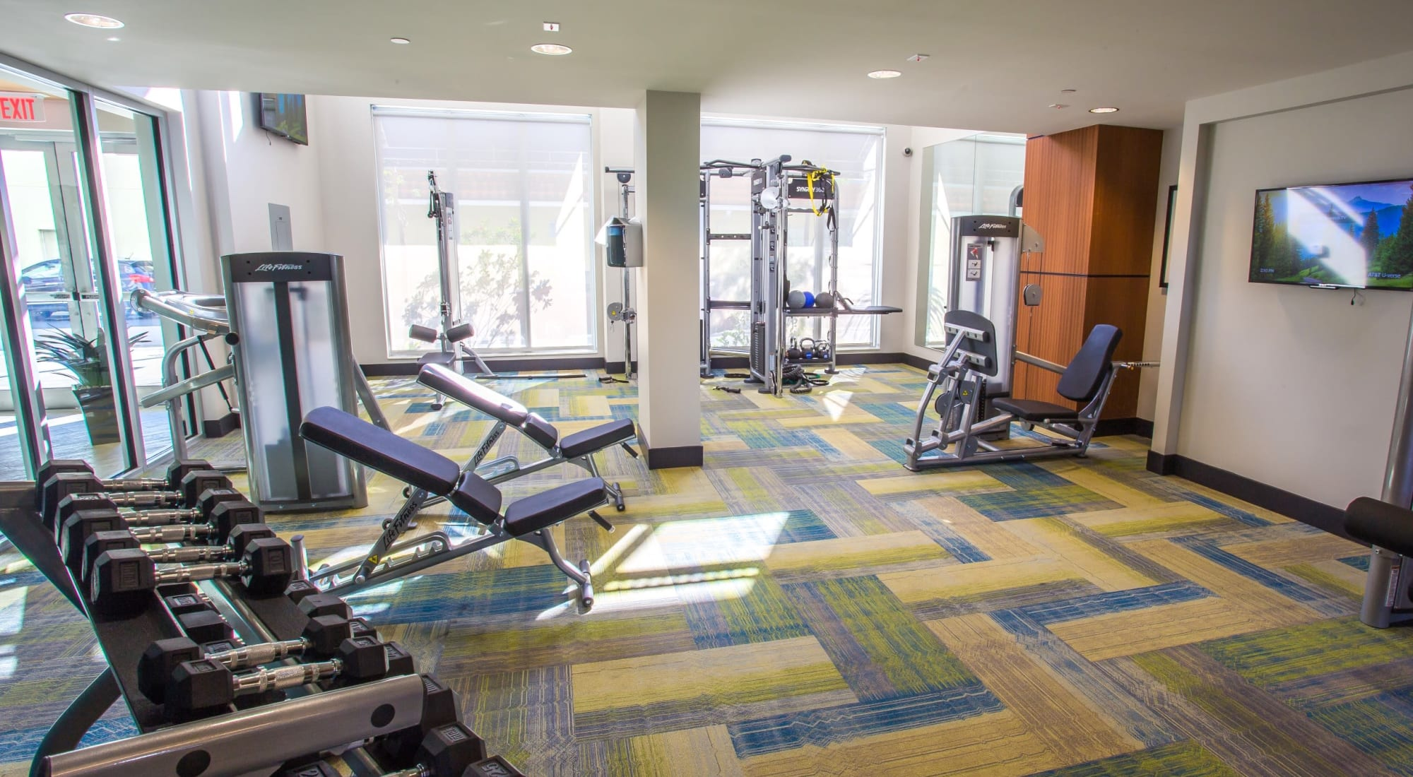 Modern fitness center at West Palm Beach, Florida, apartments at Loftin Place Apartments