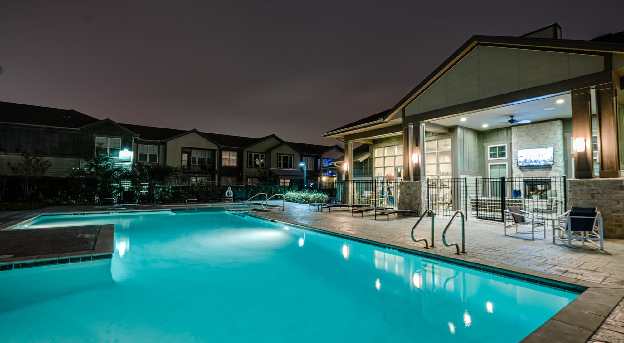 Large swimming pool with night lights at Sage Corpus Christi in Corpus Christi, Texas