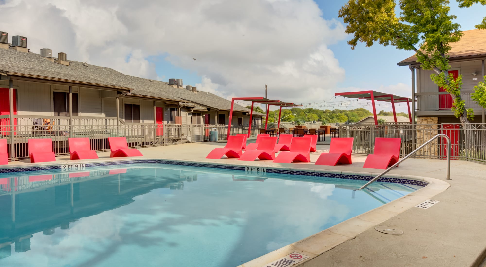 Pool with modern lounge chairs at Array Apartments in Austin, Texas