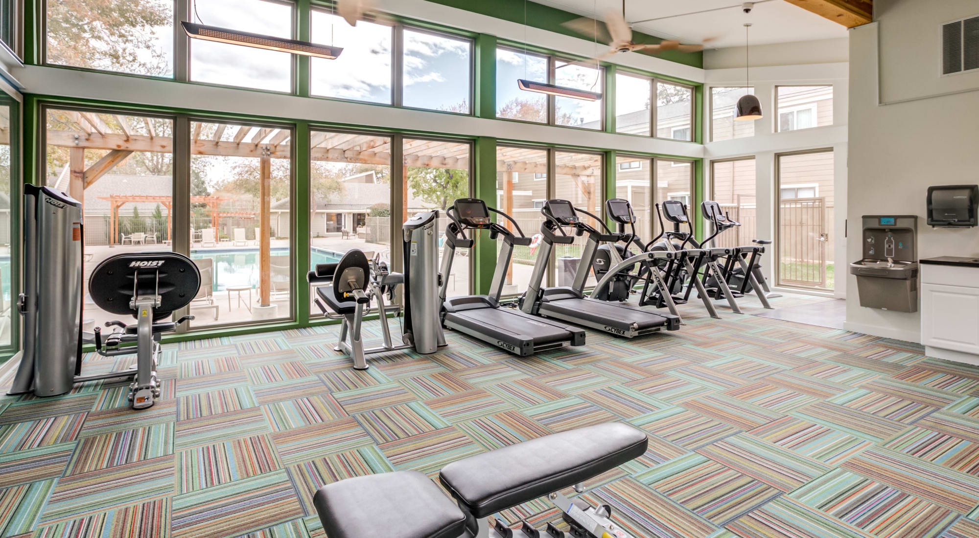 Well-equipped fitness center at The Ranch at Bear Creek Apartments & Townhomes in Lakewood, Colorado