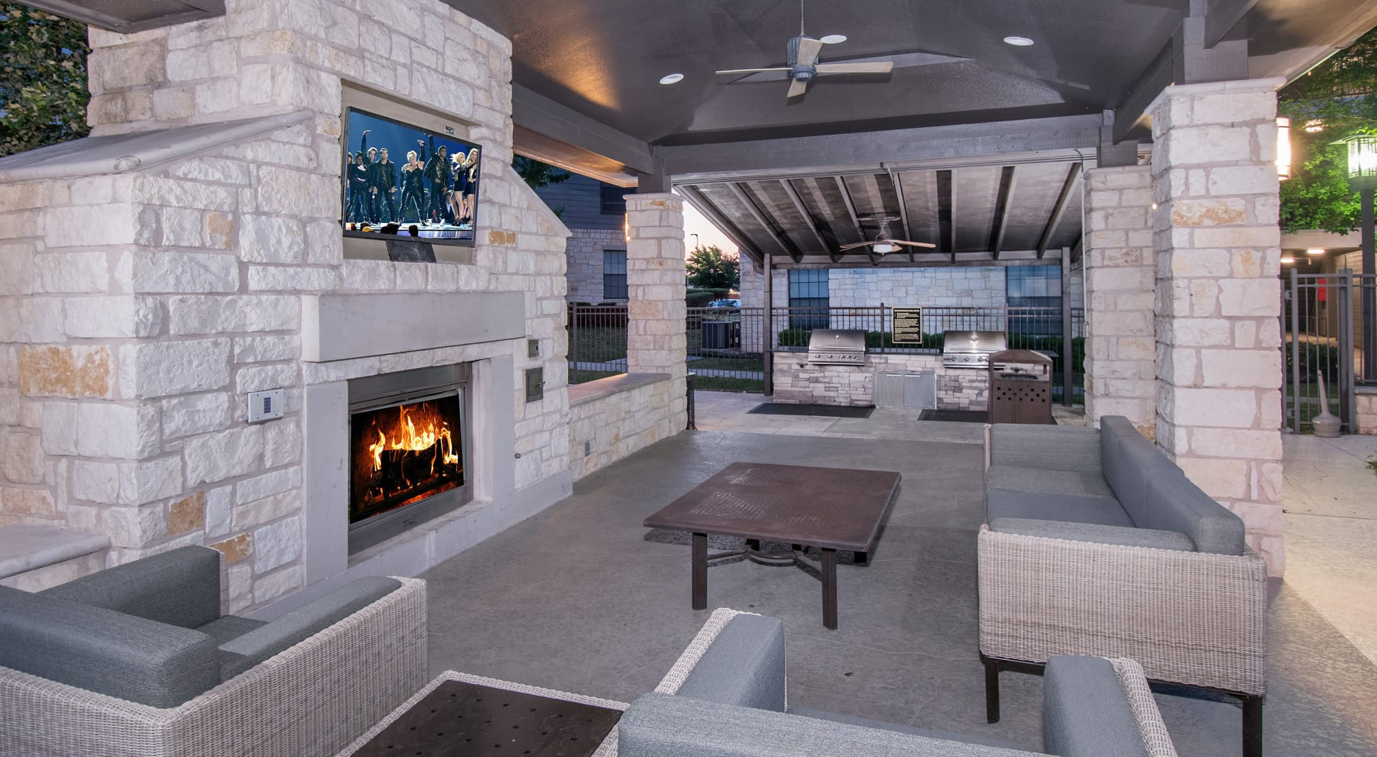 Outdoor lounge with fireplace at Villas Tech Ridge in Pflugerville, Texas