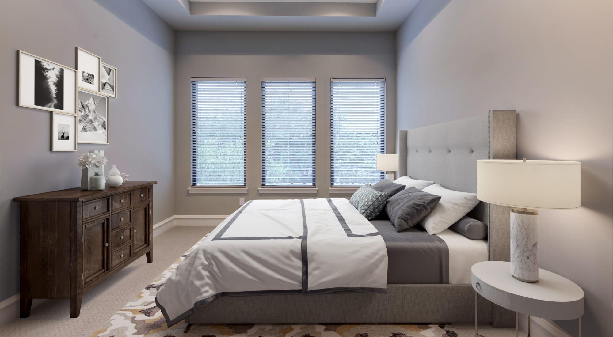 Bedroom of model unit at Rienzi at Turtle Creek Apartments