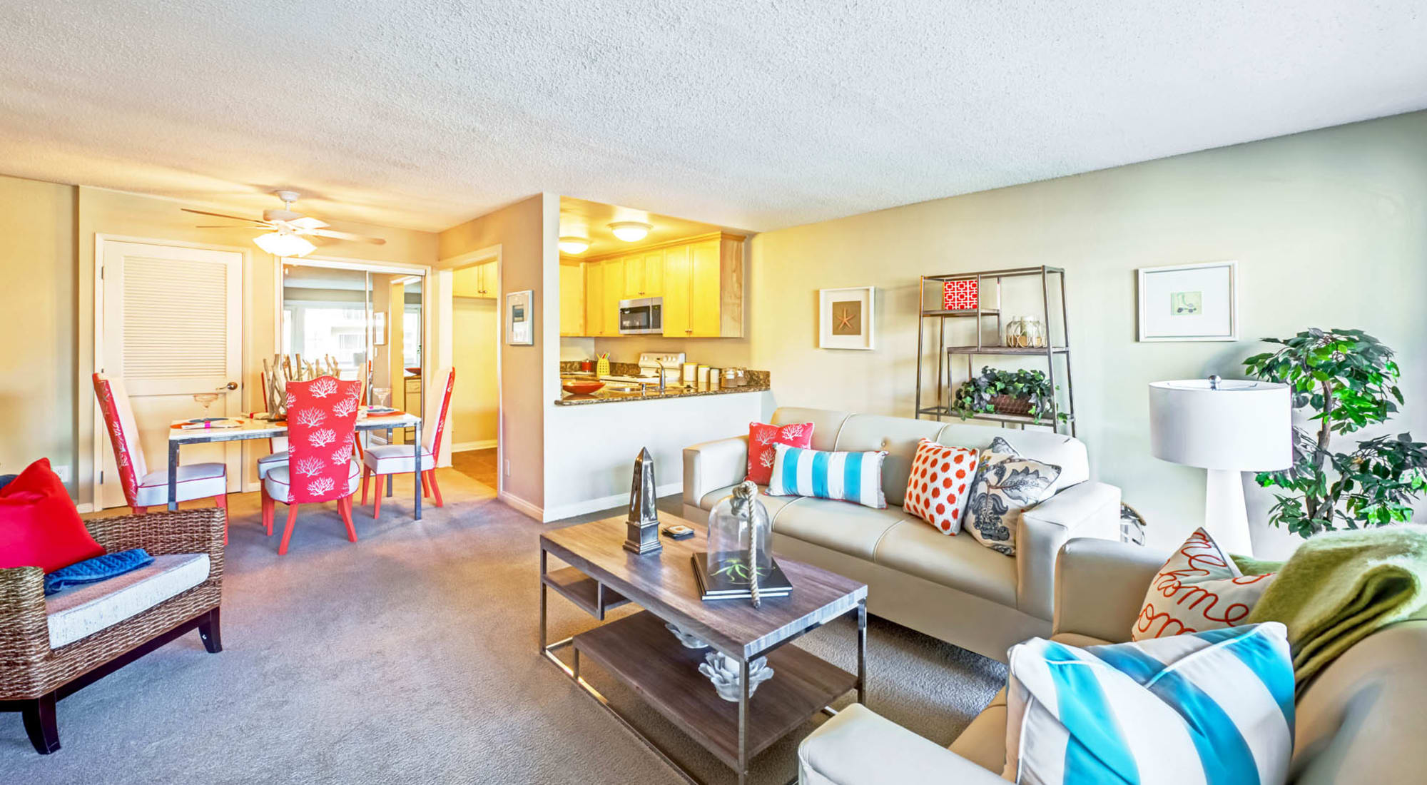 Well-furnished open-concept living space in a model home at The Tides at Marina Harbor in Marina Del Rey, California