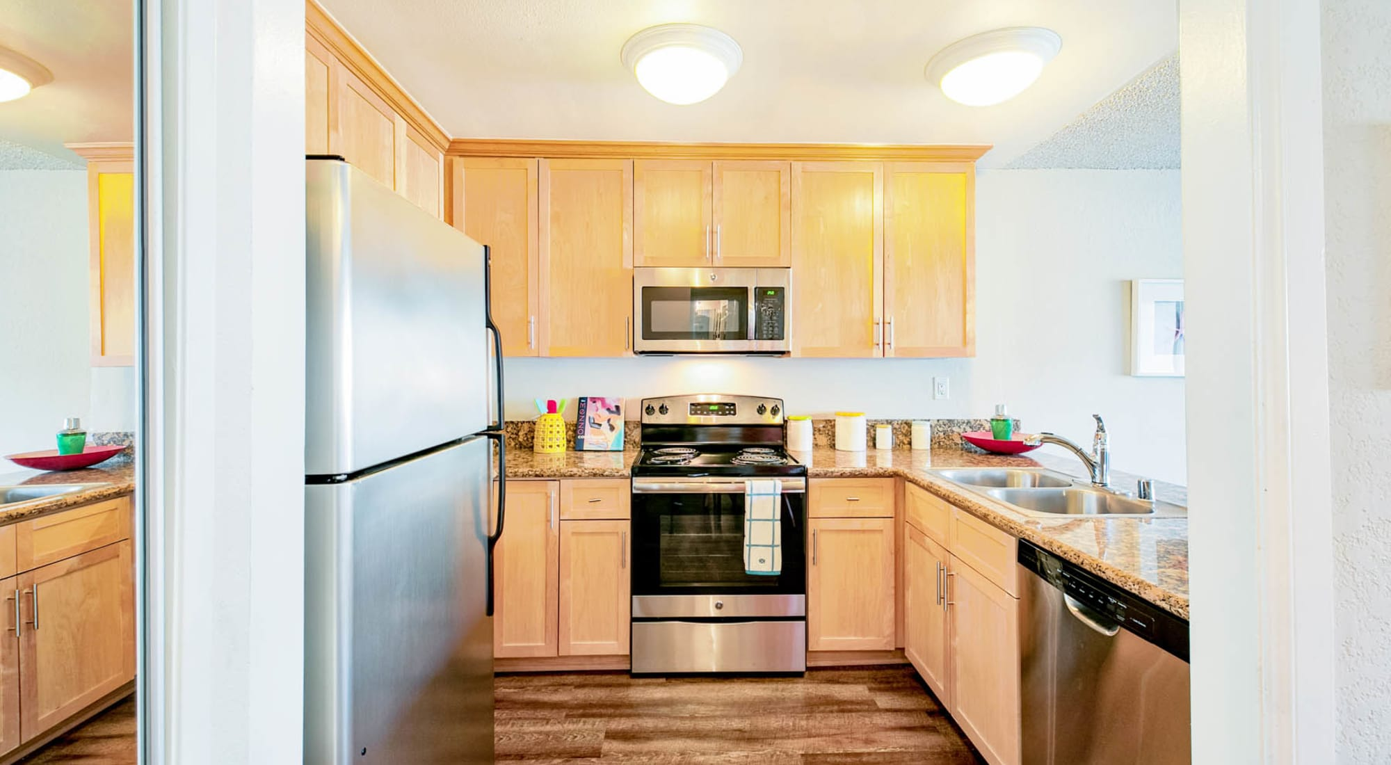 Stainless-steel appliances and hardwood flooring in a model home's kitchen at The Tides at Marina Harbor in Marina Del Rey, California