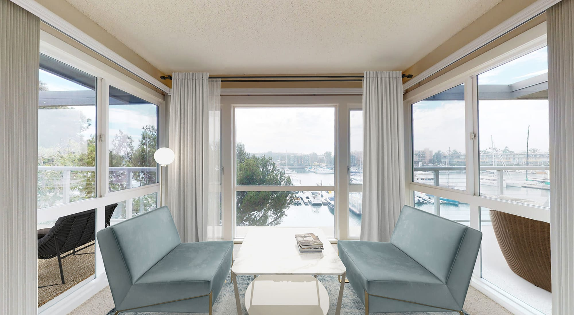 Stylish seating area with expansive waterfront view in a spacouis apartment home at The Tides at Marina Harbor in Marina Del Rey, California