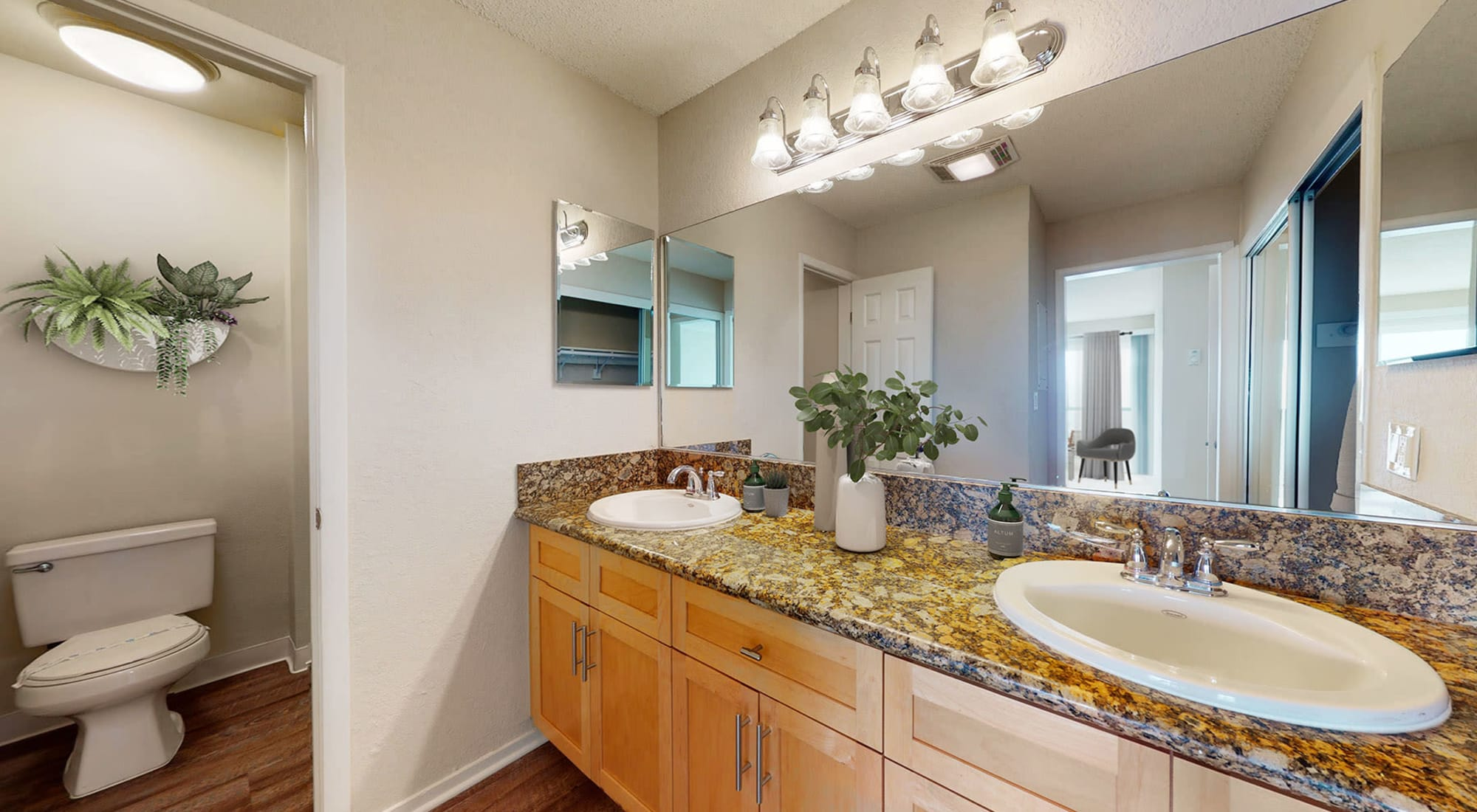 Bathroom with granite countertops and double sink in a spacious apartment home at The Tides at Marina Harbor in Marina Del Rey, California