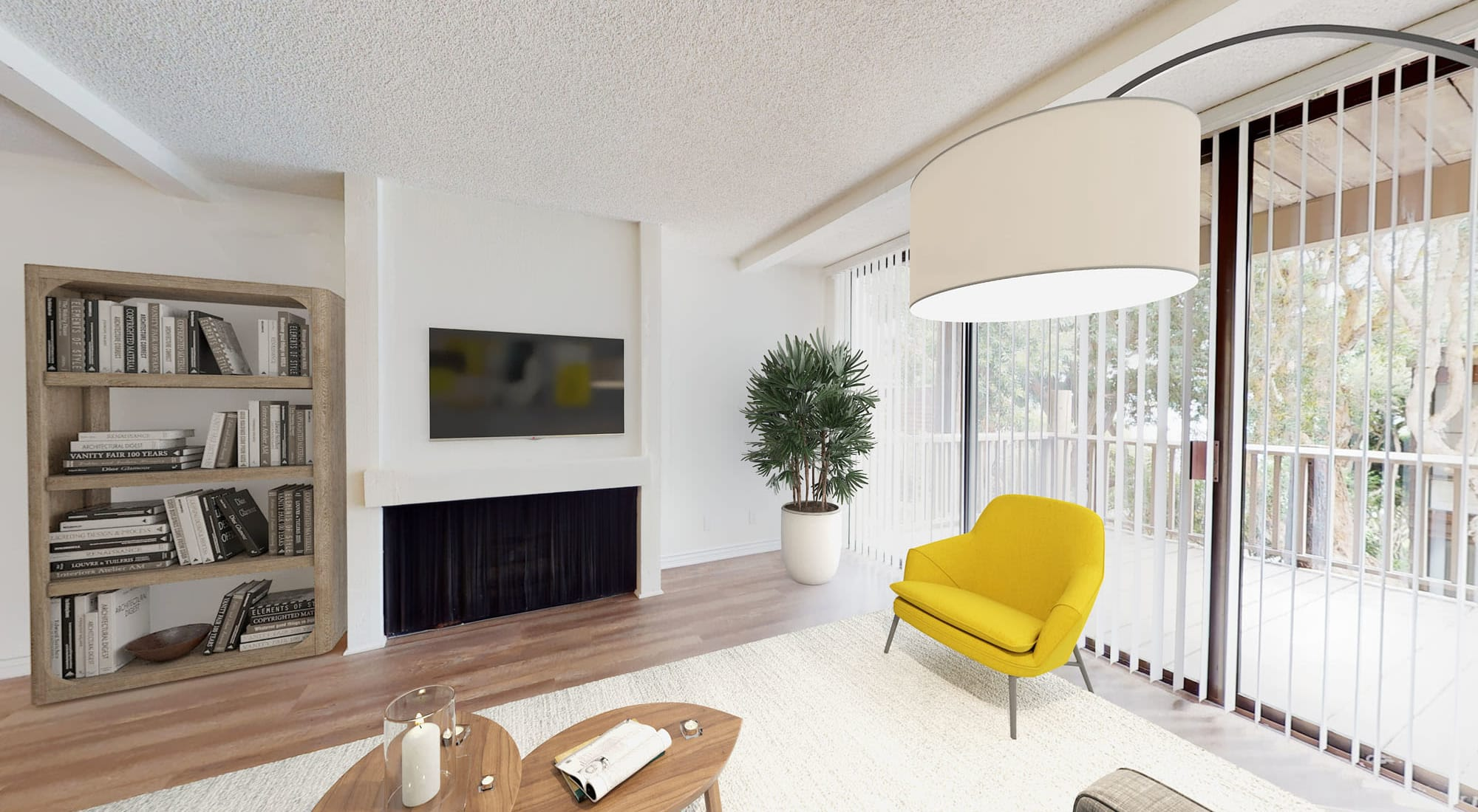 Built-in bookshelves and ample natural light filling a model home's living area at Mariners Village in Marina del Rey, California