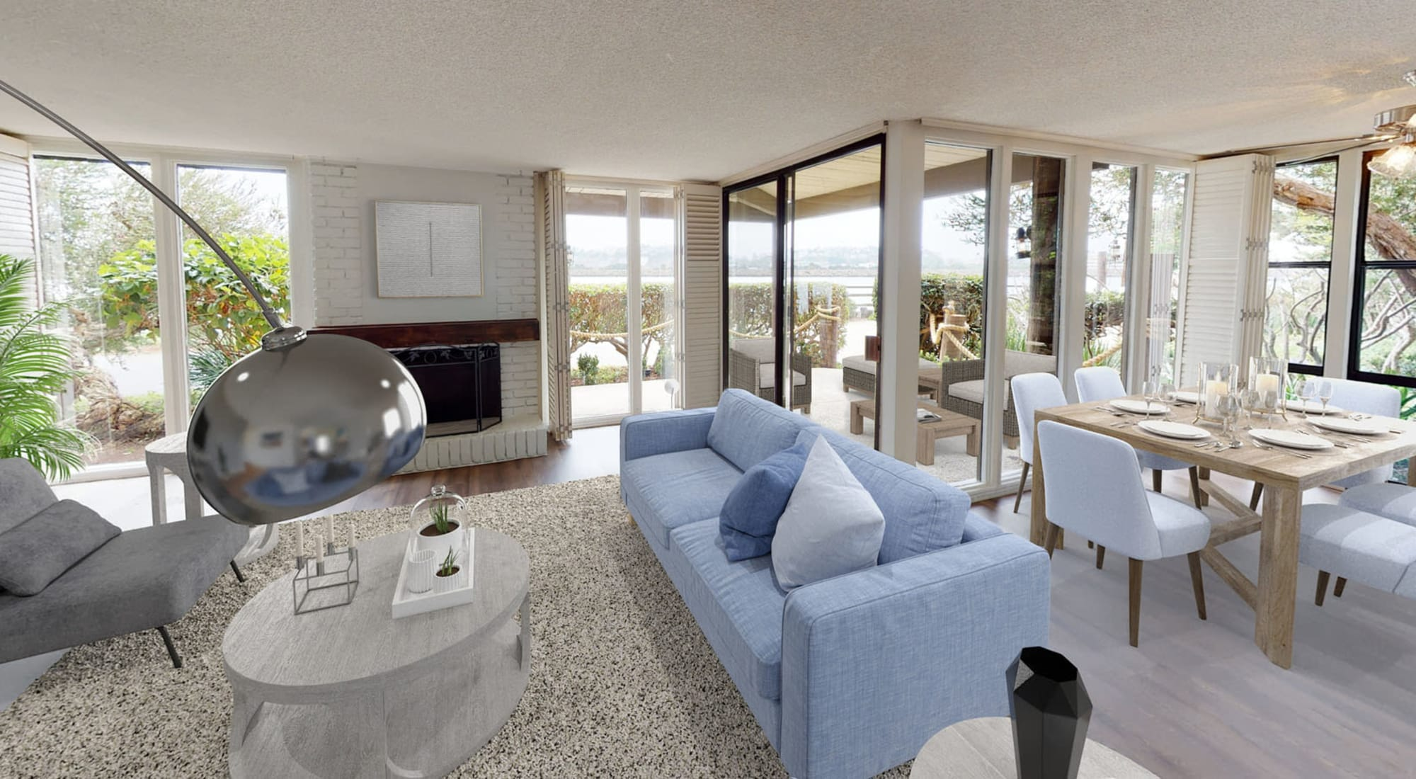 Plush carpeting and floor-to-ceiling windows in a model home's living area at Primary bedroom with large bay windows and a walk-in closet in a model home at Mariners Village in Marina del Rey, California