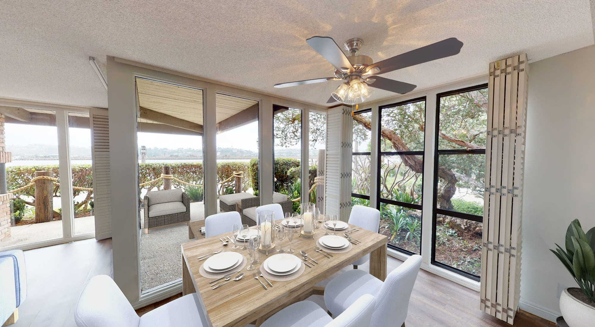 Ceiling fan and a large dining area in a model home at Primary bedroom with large bay windows and a walk-in closet in a model home at Mariners Village in Marina del Rey, California