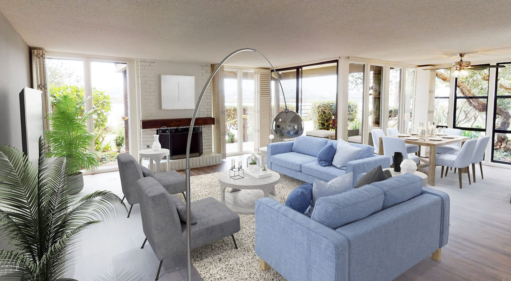 Modern furnishings and a fireplace in a model apartment at Primary bedroom with large bay windows and a walk-in closet in a model home at Mariners Village in Marina del Rey, California